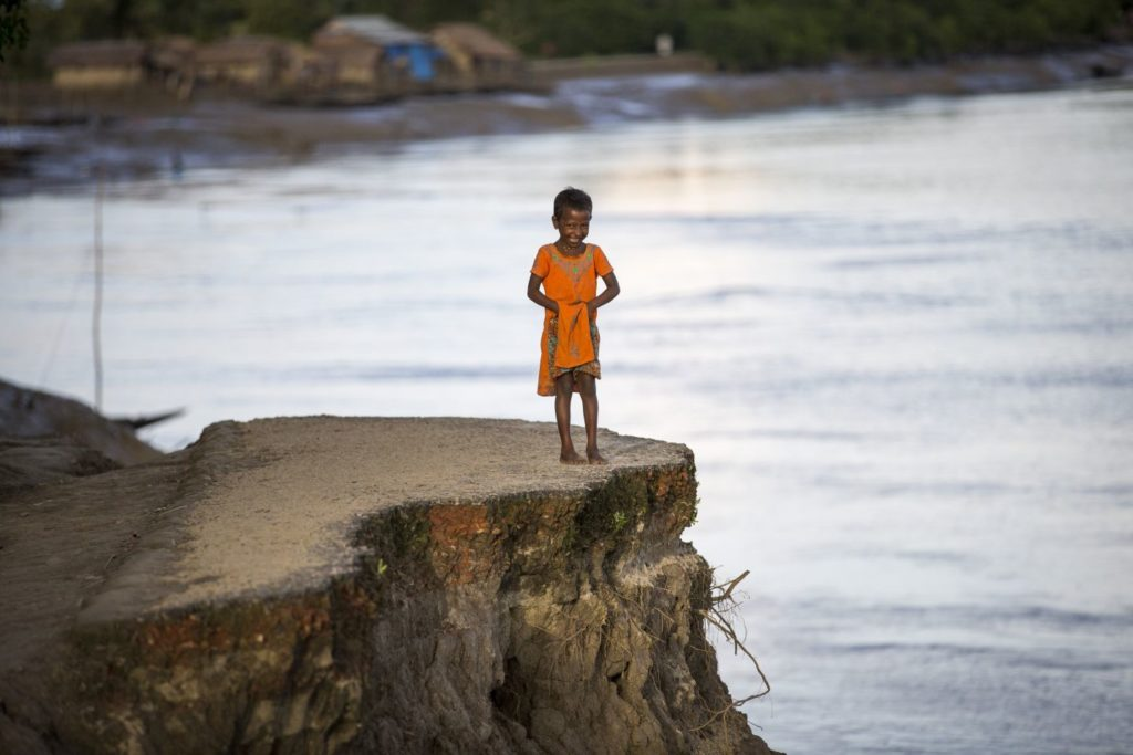 A child on an eroded shore