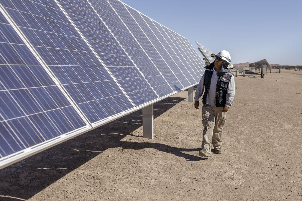 A man controls solar panels