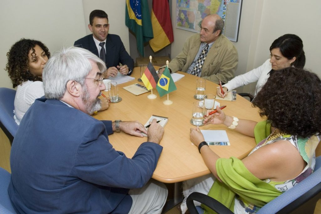 A group of people discusses something at a table