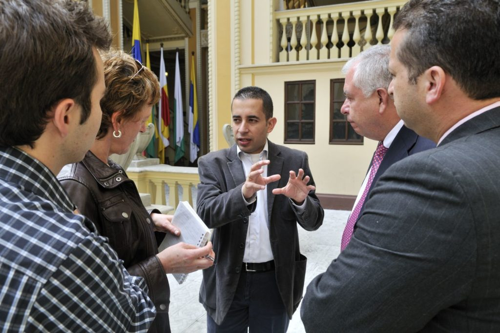 A man explains something to four people