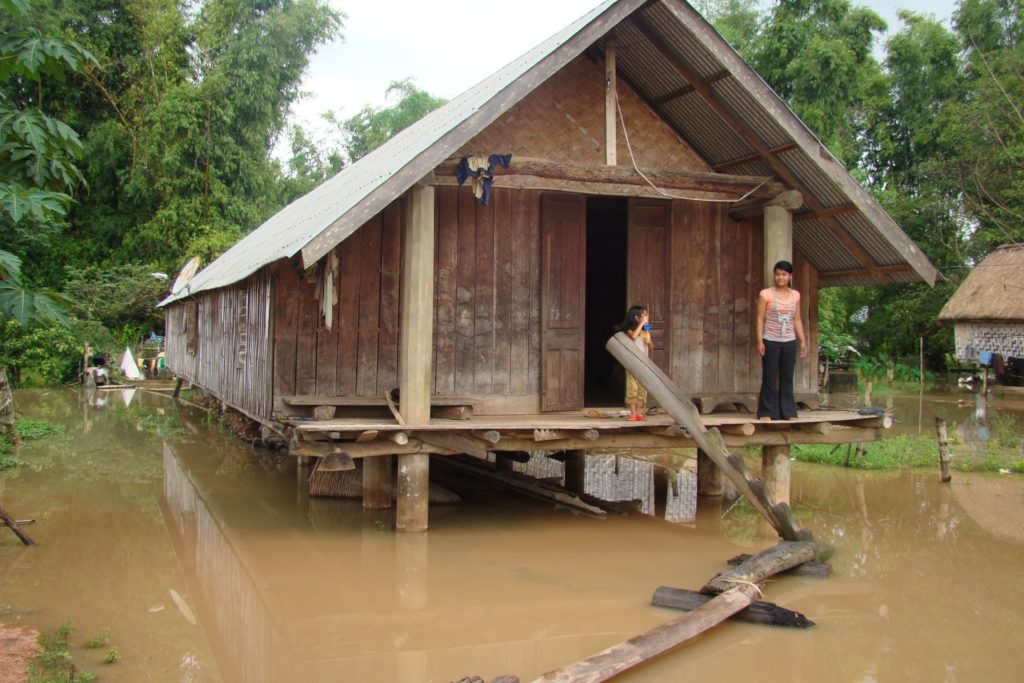 A house on stilts during flood
